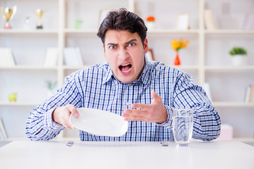 Man on diet waiting for food in restaurant