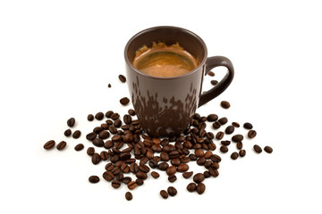 Brown cup of coffee stock images. Brown cup of coffee on a white background. Cup of coffee with coffee beans