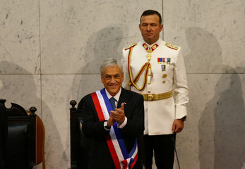 Chile's President Sebastian Pinera stands after being sworn in at the Congress in Valparaiso