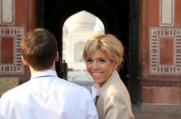 French President Emmanuel Macron and his wife Brigitte Macron visit the Taj Mahal complex in Agra