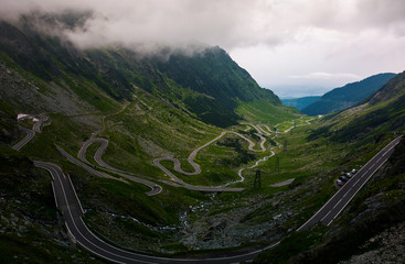 Transfagarasan road view from the cliff. dramatic moment before the storm
