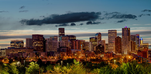 Denver Colorado in the early morning with clouds in the sky
