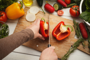 Woman's hand cutting fresh tomatoes