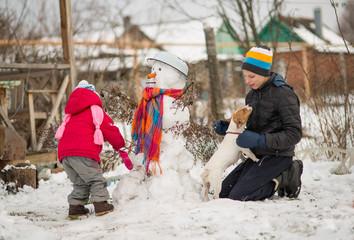 Children mold Snowman