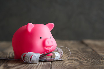 pink piggy Bank on wooden background