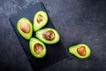 Fresh  avocado on a black background