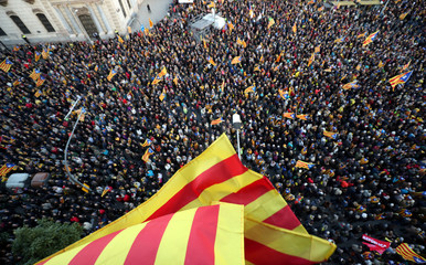 "People fly ""Esteladas"" (Catalan separatist flag) during a demonstration held by pro-independence associations in Barcelona"