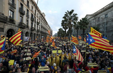 People attend a demonstration held by pro-independence associations in Barcelona
