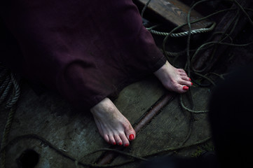 A crew member that arrived with Saint Patrick wears red toe-nail polish during the re-enactment of the first landing of Saint Patrick in Ireland takes place at Inch Abbey in Downpatrick