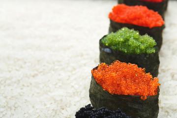 Closeup of sushi gunkan on white rice background