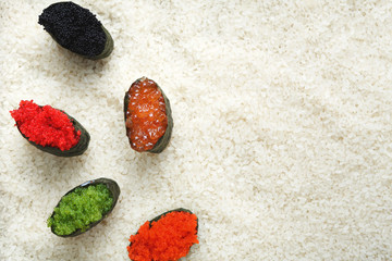 Top view on sushi gunkan on white rice background