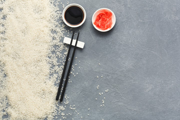 Top view on chopsticks, soy sauce and ginger