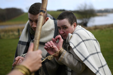 Actors playing slaves are seen during the re-enactment of the landing of Saint Patrick in Ireland at Inch Abbey in Downpatrick