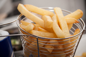 closeup of french fries in a metalic basket
