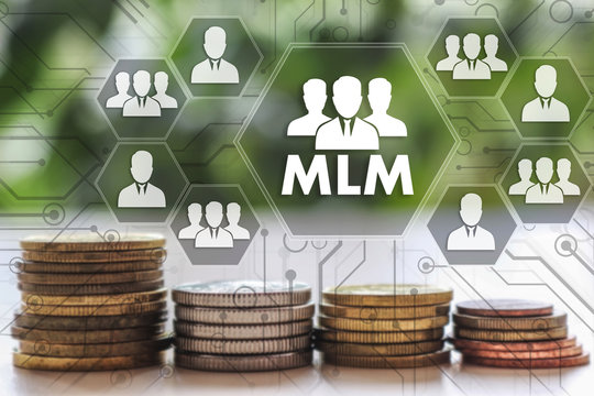 Multi-level marketing. MLM on the touch screen with a  blur financial background .The concept MLM, multi-level marketing