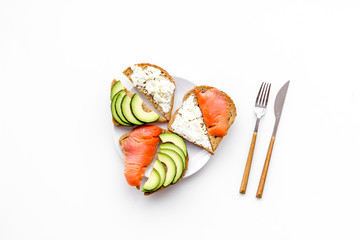 fitness breskfast with homemade sandwiches on white background top view mockup
