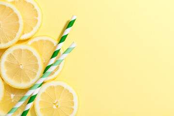 slices of lemon on yellow background