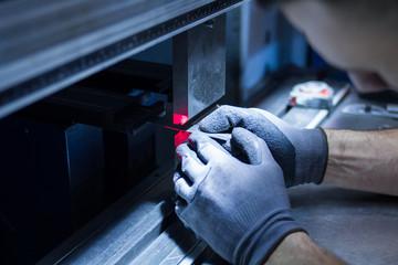 operator working cut and bending metal sheet