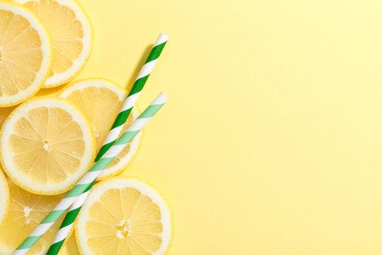 slices of lemon on yellow background