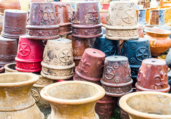 stacks of colorful vintage ceramic pottery with Texan and southwestern designs