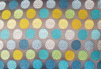 background texture close up of multicolored textile circle pattern