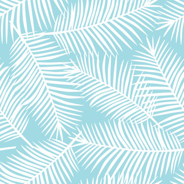 white palm leaves on a blue background exotic tropical hawaii seamless pattern vector