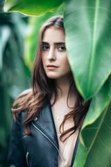 Fashion close up portrait of beautiful woman in bush