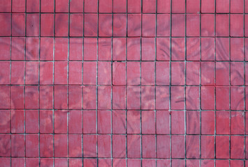 Texture of old painted brick pattern, dark pink brick wall