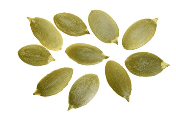 Pumpkin seeds or pepitas, isolated on white background. Top view. Flat lay
