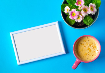 Photo frame flowers coffee cappuccino cup tender romantic blue background Your photo text