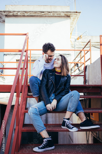Happy Smiling And Laughing Young Couple In Trendy