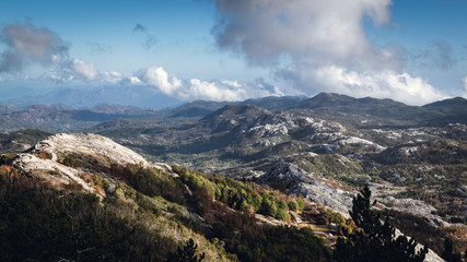 A magnificent view from Lovcen mountain, Lovcen National Park, Kotor, Montenegro. Blue sky, clouds, forests and mountain chain