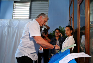 Cuba's First Vice-President Miguel Diaz-Canel casts his vote during an election of candidates for the national and provincial assemblies, in Santa Clara