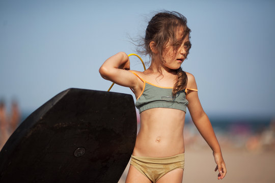 Little girl with surfboard