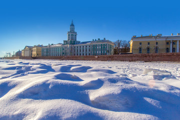 River Neva in the ice. Embankment of St. Petersburg. Winter in Russia. View of the museum of the Kunstkammer in St. Petersburg. Russia. Museums and architecture of St. Petersburg.