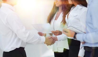 handshake business women and business partner