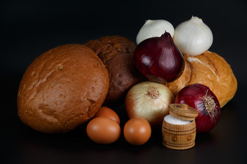 Still life. Bread, eggs, bulbs and salt