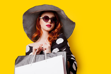 woman in sunglasses with shopping bags