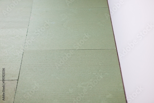 Laying Laminate Flooring Insulated Underlay On Floor Ready For The Click Lock Wood Effect