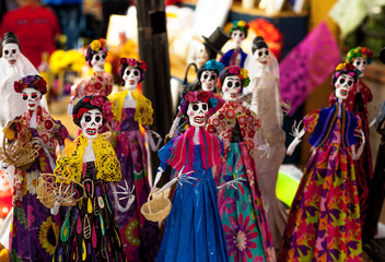 Small skeleton mannequins dressed and decorated for Dia de los Muertos/Day of the Dead