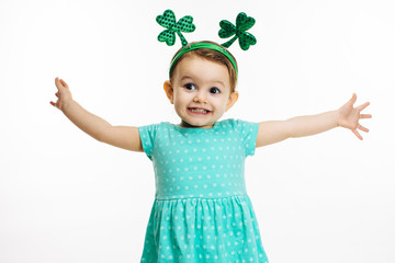 St.Patrick's day clover head decoration on an excited toddler girl