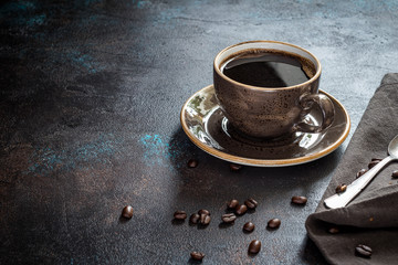 Cup of coffee on a rusty background