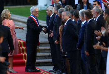Chile's  President Sebastian Pinera greets people at La Moneda Presidential Palace in Santiago