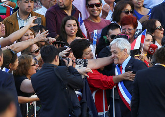 Chile's  President Sebastian Pinera greets people at La Moneda Presidential Palace in Santiago