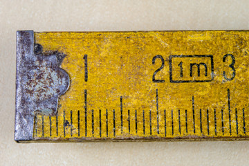 Old measure carpentry on a wooden workshop table. Joinery accessories shown in a large magnification.