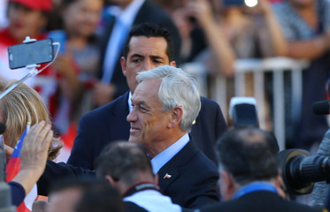 Chile's  President Sebastian Pinera arrives to La Moneda Presidential Palace in Santiago,