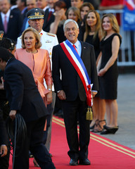 Chile's President Sebastian Pinera accompanied by his wife, first lady Cecilia Morel arrives at La Moneda Presidential Palace in Santiago,