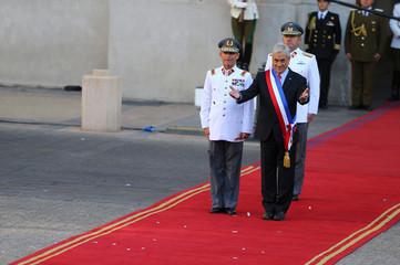 Chile's President Sebastian Pinera reacts at La Moneda Presidential Palace in Santiago, Chile