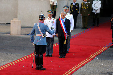 Chile's President Sebastian Pinera looks on at La Moneda Presidential Palace in Santiago, Chile