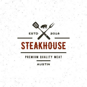 vintage steak house logo. retro styled grill restaurant emblem. vector illustration
